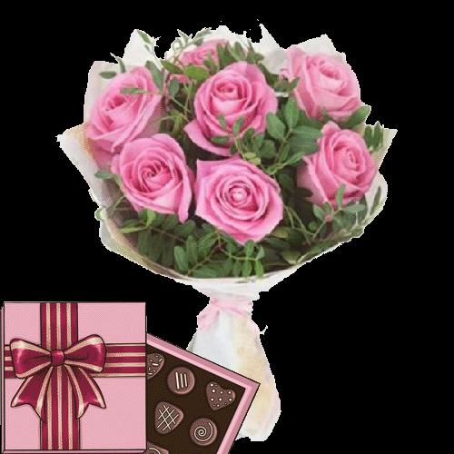 Фото товара 7 розовых роз с зеленью и конфеты в Мариуполе